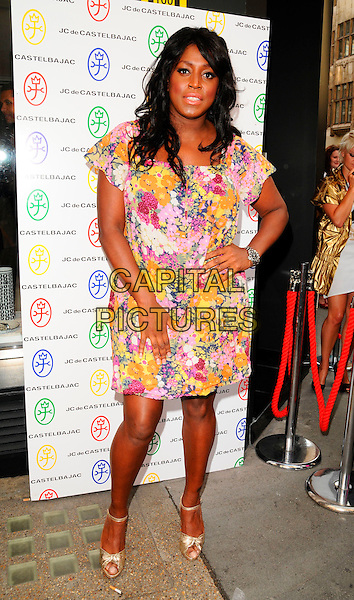MICA PARIS .The JC de Castelbajac London flagship store launch, 50/51 Conduit St., London, England..June 5th, 2008.JC/DC JC / DC full length pink dress orange hand on hip gold shoes floral print.CAP/CAN.©Can Nguyen/Capital Pictures.