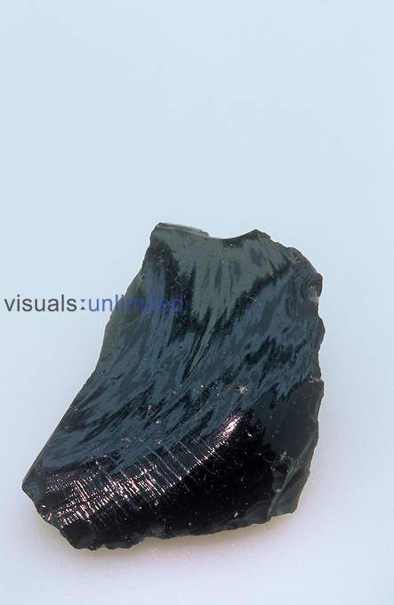 Obsidian, an glassy extrusive volcanic or igneous rock.