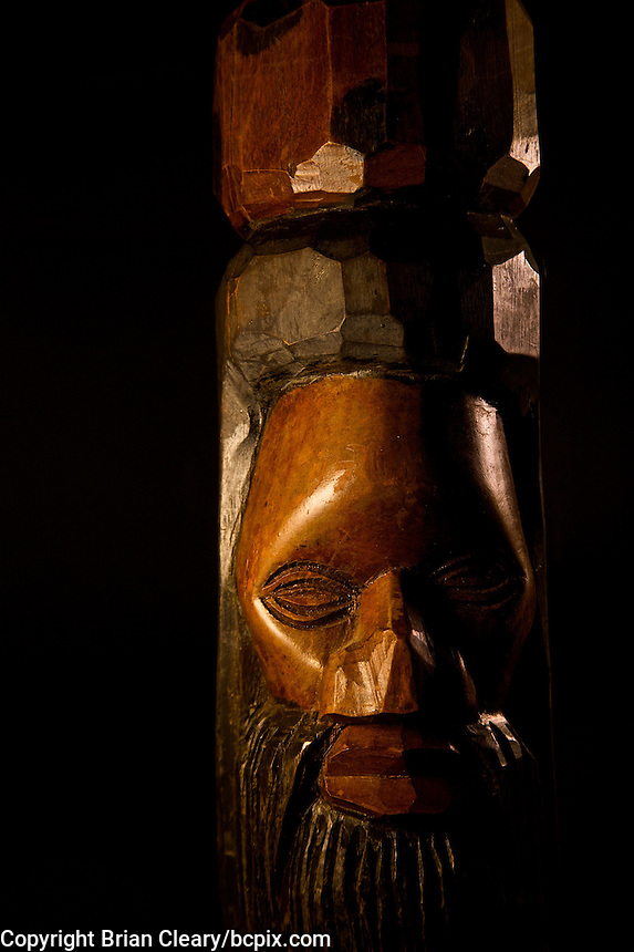 A hand-carved wooden bust of an African man  photographed in the studio.  (Photo by Brian Cleary/www.bcpix.com)