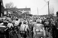 peloton and fans up The Valkenberg<br /> <br /> Omloop Het Nieuwsblad 2014