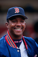 OAKLAND, CA - Pedro Martinez of the Boston Red Sox smiles in the dugout during a game against the Oakland Athletics at the Oakland Coliseum in Oakland, California in 1999. Photo by Brad Mangin