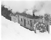 A 3/4 right-side view of C&amp;TS rotary snowplow #OM in a small amount of snow east of Chama.<br /> C&amp;TS  e. of Chama, NM