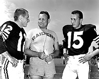 Oakland Raiders first coach Eddie Erdelatz with quarterbacks (#12 unidentified) and #15 Tom Flores..(1960 photo/Ron Riesterer)
