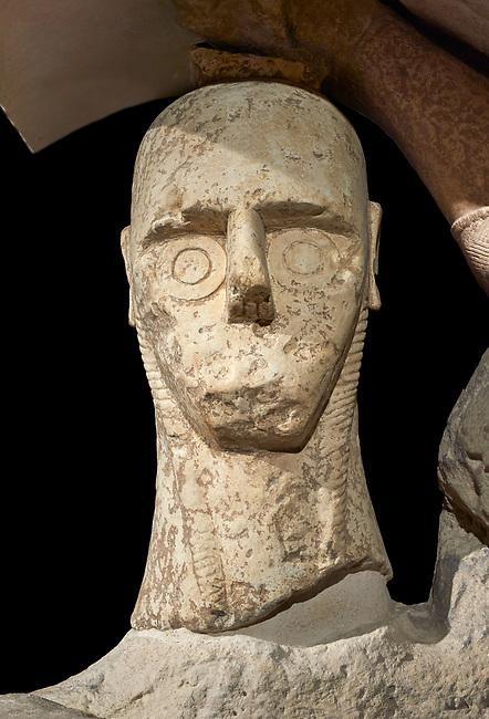 Close up of head of 9th century BC Giants of Mont'e Prama  Nuragic stone statue of a boxer, Mont'e Prama archaeological site, Cabras. 2014 excavation. Civico Museo Archeologico Giovanni Marongiu - Cabras, Sardinia. Black background
