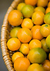 Small orange limes for sale in a market on the island of Kauai, Hawaii. Photo by Kevin J. Miyazaki/Redux