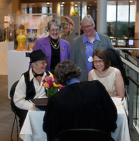 Lynn Childs, left, and Karen Swanson meet with the judge before their wedding at Seattle City Hall on December 9, 2012. They were married along with 137 other couples.