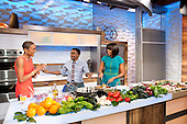 "First Lady Michelle Obama, ""Good Morning America"" anchor Robin Roberts, and chef Marcus Samuelsson participate in a cooking segment at the GMA Studios in New York, New York, February 22, 2013. .Mandatory Credit: Chuck Kennedy - White House via CNP"
