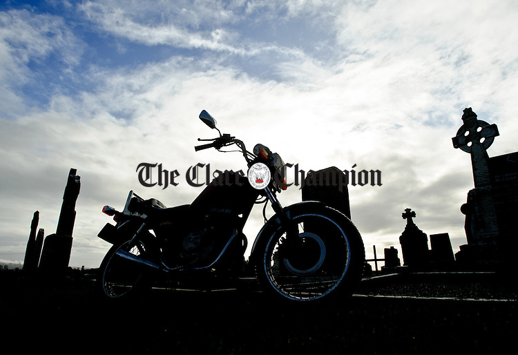 Highway To Heaven...A Honda motorbike awaits the return of it's owner after his day's work in Feakle Graveyard. Photograph by John Kelly.