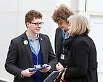 © Joel Goodman - 07973 332324 - all rights reserved . 06/03/2011 . Cardiff , UK . Young Conservative delegate WILLIAM MILLARD asks THERESA MAY to sign a copy of the party manifesto on day 2 of the Conservative Party Spring Conference at the Swalec Stadium . Photo credit : Joel Goodman