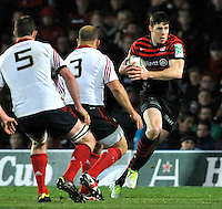 Watford, England. Joel Tomkins of Saracens charges forward during the Heineken Cup match between Saracens and Munster Rugby at the Vicarage Road on December 16, 2012 in Watford, England.