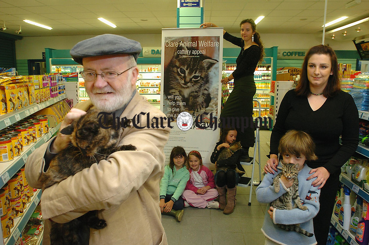 "At the launch of the Clare Animal Welfare  Cattery Appeal at Shaughnessy's Mace shop on Station road, Ennis were, Jimmy Murphy with ""Mrs Tigger"", a 15 year old rescued cat, Michaela Hanrahan, Erin Roche, Isabel Spellissey with ""Goose"", Kate taylor, CAW member, Amy O Shaughnessy, shopkeeper and tull Spellissey with ""Express"". Photograph by John Kelly."
