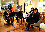Virtuosi of Houston performs at an evening honoring The Houston Symphony Young Associates Council at the Louis Vuitton store in the Galleria Thursday August 15, 2013.(Dave Rossman photo)