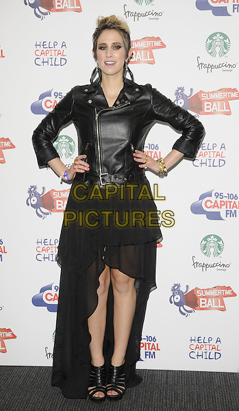 DEV (Devin Tailes).The Capital FM Summertime Ball, Wembley Stadium, London, England..June 12th, 2011.full length black leather jacket sheer dress hands on hips sandals wedges shoes .CAP/CAN.©Can Nguyen/Capital Pictures.