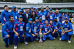 Players and team officials of Kowloon Cantons team, and guests pose with their trophy after winning the final match of the Hong Kong T20 Blitz between Kowloon Cantons and City Kaitak at Tin Kwong Road Recreation Ground, Hong Kong, China. Photo by Chris Wong / Power Sport Images