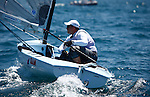 Day 3 of the Sail Sydney 2009 regatta, Finn Olympic class..Held annually Sail Sydney take place from the 5-8 December 2009 on the magnificent Sydney Harbour as part of the Sail Down Under series, incorporating Sail Brisbane, Sail Sydney and Sail Melbourne..Competitors from around the world bring Sydney Harbour to life as athletes look to establish themselves on the sailing scene in the lead up to the London Olympics in 2012..The four day regatta incorporate Olympic, International and Youth classes on the three Sydney Harbour courses used by the 2000 Sydney Olympics. Spectacular action from the 49er and International Moth classes can be expected along with the Laser, Laser Radial, Finn, RS:X and 470s as they campaign towards 2012..Over 400 participate and sail out of host venue: Woollahra Sailing Club in Rose Bay.