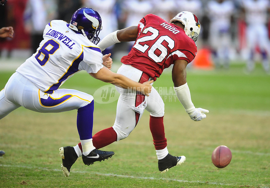 Dec. 14, 2008; Glendale, AZ, USA; Arizona Cardinals cornerback (26) Roderick Hood reaches for the blocked kick as Minnesota Vikings kicker (8) Ryan Longwell pursues him at University of Phoenix Stadium. Hood returned the blocked kick for a touchdown. Mandatory Credit: Mark J. Rebilas-