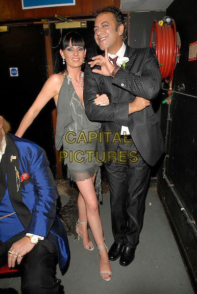 LUCY PARGETER & JIMMI HARKISHIN.At the Miss Great Britain 2007 Grand Final,.Grosvenor House Hotel, Park Lane, London, England, .May 21st 2007..full length grey dress black suit funny Jimmy.CAP/FIN.©Steve Finn/Capital Pictures.