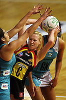 Thunderbirds wing defence Joanne Sutton tries to block Laura Langman during the ANZ Netball Championship match between the Waikato Bay of Plenty Magic and Adelaide Thunderbirds, Mystery Creek Events Centre, Hamilton, New Zealand on Sunday 19 July 2009. Photo: Dave Lintott / lintottphoto.co.nz