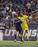 New England Revolution midfielder Marko Perovic (29) and Columbus Crew defender Andy Iro (6) battle for head ball. The New England Revolution tied Columbus Crew, 2-2, at Gillette Stadium on September 25, 2010.