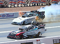 Apr 12, 2015; Las Vegas, NV, USA; NHRA funny car driver Tim Wilkerson (near lane) races alongside John Hale during the Summitracing.com Nationals at The Strip at Las Vegas Motor Speedway. Mandatory Credit: Mark J. Rebilas-