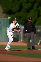 Burlington Bees first baseman Nick Flair (36) flips the ball to first as umpire C.J. Davis looks on during a game against the Clinton LumberKings on August 20, 2015 at Community Field in Burlington, Iowa.  Burlington defeated Clinton 3-2.  (Mike Janes/Four Seam Images)