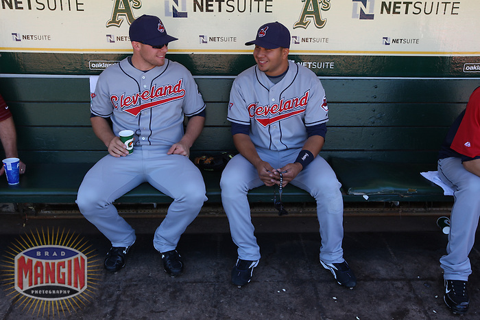 OAKLAND, CA - SEPTEMBER 19:  Chris Gimenez #8 and Jhonny Peralta #2 of the Cleveland Indians get ready in the dugout before the game against the Oakland Athletics at the Oakland-Alameda County Coliseum on September 19, 2009 in Oakland, California. Photo by Brad Mangin