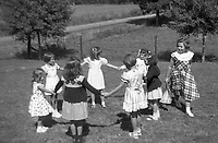 "A group of girls plays ""ring around the rosies"" in a filed in 1940's america.  (Photo by bcpix.com)"