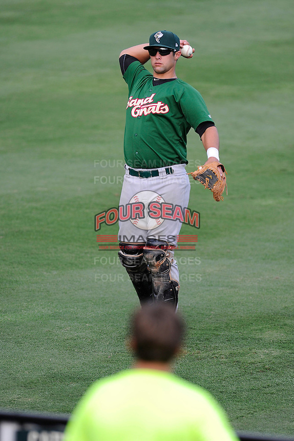 Catcher Colton Plaia (8) of the Savannah Sand Gnats plays catch with young fans in the left field berm before a game against the Greenville Drive on Friday, August 22, 2014, at Fluor Field at the West End in Greenville, South Carolina. Greenville won, 6-5. (Tom Priddy/Four Seam Images)