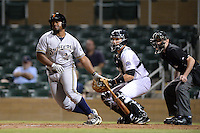 Surprise Saguaros outfielder Jason Rogers (26), of the Milwaukee Brewers organization, at bat in front of catcher Dustin Garneau and umpire Jeff Morrow during an Arizona Fall League game against the Salt River Rafters on October 15, 2013 at Salt River Fields at Talking Stick in Scottsdale, Arizona.  Surprise defeated Salt River 9-2.  (Mike Janes/Four Seam Images)