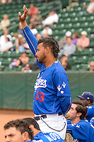 Ogden Raptors coach Angel Sanchez (33) signals to the infield during the game against the Idaho Falls Chukars in Pioneer League action at Lindquist Field on August 26, 2015 in Ogden, Utah.Ogden defeated the Chukars 5-1.  (Stephen Smith/Four Seam Images)