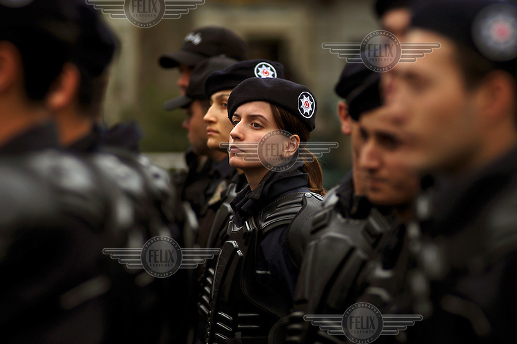 Riot police stand guard as Islamists demonstrate in front of the Beyiazid mosque against the visit of Pope Benedict XVI to Turkey.