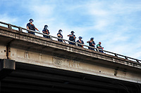 AUSTIN, TEXAS - MAY 30: Austin Police officers standing on IH-35 point their weapons at the crowd of Black Lives Matter protesters below the bridge on May 30, 2020 in Austin, Texas.<br /> <br /> Use of this image in advertising or for promotional purposes is prohibited.<br /> <br /> Editorial Credit: Photo by Dan Herron / Herron Stock