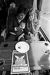 "Paul and Linda McCartney Wings Tour 1975. Paul and Linda share a quite moment on their tour bus while traveling  to Cardiff for that night performance. England. The photographs from this set were taken in 1975. I was on tour with them for a children's ""Fact Book"". This book was called, The Facts about a Pop Group Featuring Wings. Introduced by Paul McCartney, published by G.Whizzard. They had recently recorded albums, Wildlife, Red Rose Speedway, Band on the Run and Venus and Mars. I believe it was the English leg of Wings Over the World tour. But as I recall they were promoting,  Band on the Run and Venus and Mars in particular."