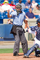 Home plate umpire Shane Livensparger makes a strike call during the South Atlantic League game between the Hagerstown Suns and the Rome Braves at State Mutual Stadium on May 2, 2011 in Rome, Georgia.   Photo by Brian Westerholt / Four Seam Images