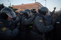 Police enter into Lubyanka Square during an unsanctioned anti-Putin demonstration in Moscow, Russia.  Police arrested a number of protesters and opposition leaders.