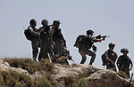 Israeli border police take position during clashes between Palestinian villagers from Oref and Jewish settlers after Israeli settlers attacked villages near Nablus City 30 April 2013. Reports state that the clashes occured after an Israeli settler was stabbed to death by a Palestinian man. Israeli media reported that the Palestinian attacker took the settlers' weapon and began firing at a nearby Israeli border guard force, who returned fire, wounding the attacker. Photo by Nedal Eshtayah
