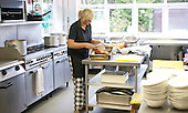 One of the cooks, Summerhill School, Leiston, Suffolk. The school was founded by A.S.Neill in 1921 and is run on democratic lines with each person, adult or child, having an equal say.  You don't have to go to lessons if you don't want to but could play all day.  It gets above average GCSE exam results.