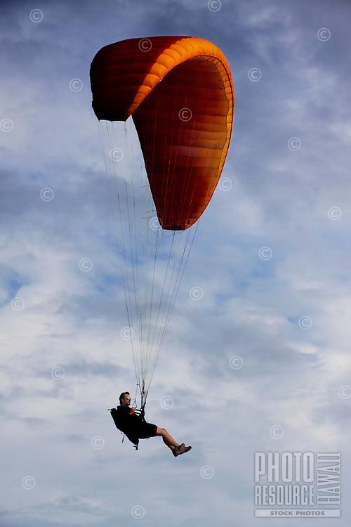A man paragliding over O'ahu.