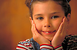 portrait of smiling young girl with missing tooth