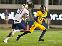 November 2nd, 2012: California's Zach Maynard runs out of the back field to avoid being tackled by Washington's Marcus Peters during a  at Memorial Stadium, Berkeley, Ca Washington defeated California 21 -13