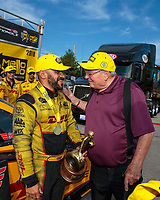 Sep 16, 2018; Mohnton, PA, USA; NHRA funny car driver J.R. Todd (left) celebrates with team owner Connie Kalitta after winning the Dodge Nationals at Maple Grove Raceway. Mandatory Credit: Mark J. Rebilas-USA TODAY Sports