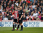 Referee John Busby and John Fleck of Sheffield Utd  during the English League One match at  Bramall Lane Stadium, Sheffield. Picture date: April 30th 2017. Pic credit should read: Simon Bellis/Sportimage