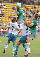 Tina Ellerton #8 of Abby's X heads the ball over Christine Sinclair #12 and Allison Falk #3I of Marta's XI to Abby Wambach #20 during the WPS All-Star game at KSU Stadium in Kennesaw, Georgia on June 30 2010. Marta XI won 5-2.