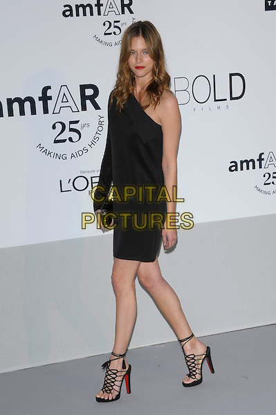 GUEST.amfAR's Cinema Against AIDS Gala during the 64th Annual Cannes Film Festival at Hotel Du Cap, Antibes, France, May 19th, 2011..full length dress black one shoulder sleeve strappy sandals .CAP/PL.©Phil Loftus/Capital Pictures