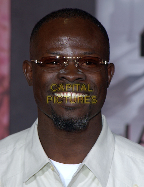 DJIMON HOUNSOU.Los Angeles Premiere of The LadyKillers held at The El Capitan Theatre in Hollywood, California .12 March 2004.*UK Sales Only*.portrait, headshot, sunglasses, shades.www.capitalpictures.com.sales@capitalpictures.com.©Capital Pictures.