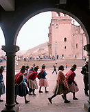 PERU, Cusco, South America, Latin America, people walking in Plaza De Armas with the Santo Domingo Cathedral in the background.