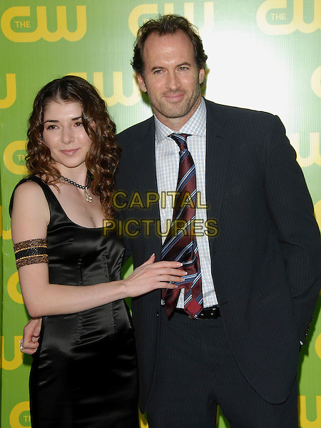 SCOTT PATTERSON & GUEST.The CW Launch Party held at Warner Brothers' Studios in Burbank, California, USA..September 18th, 2006.Ref: DVS.half length black dress blue suit jacket.www.capitalpictures.com.sales@capitalpictures.com.©Debbie VanStory/Capital Pictures