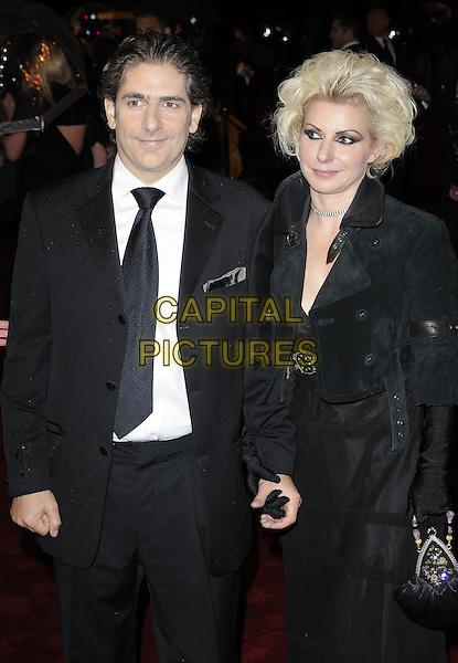 "MICHAEL IMPERIOLI & VICTORIA CHLEBOWSKI .At ""The Lovely Bones"" Royal Film Premiere, Odeon cinema Leicester Square, London, England, UK, .24th November 2009..half length black suit tie couple married husband wife cropped suede jacket gloves bag holding hands .CAP/CAN.©Can Nguyen/Capital Pictures"