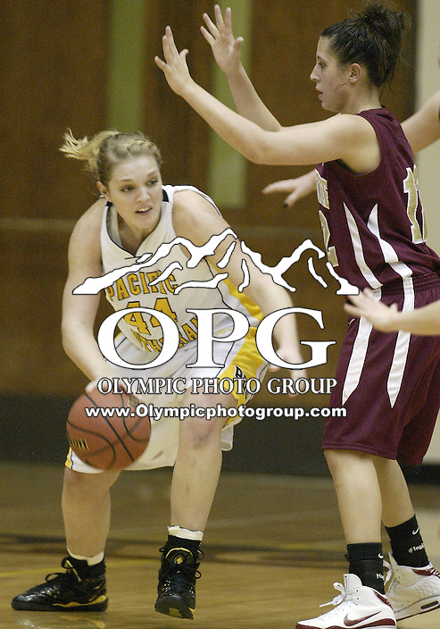02 January 2009:  Pacific Lutheran University's #44 Melissa Richardson drives past Willamette's #12 Molly Fillion at the Olson Auditorium in Tacoma, WA.  Pacific Lutheran University won 65-52 over Willamette.