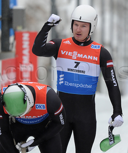 20.02.2016. Winterberg, Germany.  Oskars Gudramovics (front) and Peteris Kalnins (back)of Latvia celebrate after finishing third at the men's two-seater event at the Luge World Cup in Winterberg, Germany, 20 February 2016.